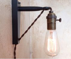 How to make a hard wire wall light into a plug in wall sconcei items similar to industrial pulley sconce lamp plug in aloadofball Gallery