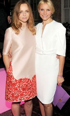Cameron Diaz wearing our Spring '14 white belted dress and Winter '13 amethyst Beckett clutch