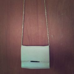 Cream w/ Gold Accent Crossbody Great condition except for a few marks and stains inside. Photos are provided. Can't be seen when worn from the outside. Damages are reflected in price. Forever 21 Bags Crossbody Bags