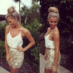 white loose fit shirt into skirt, hair in bun