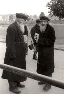 Wetzlar, Germany, Rabbi Issac Hertzberg speaking with Rabbi Eisen during Sukkot in the DP camp, postwar.
