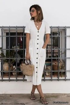 Loose linen in white with straw bag and brown leather sandals. Instant summer chic