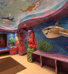 Cool wall painting for playroom designs with small lamps and like under water nuance and drop ceiling model