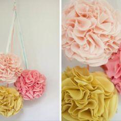 Fabric Pom Poms Great for a baby girl's nursery  http://www.oncewed.com/24140/wedding-blog/diy-wedding/diy-fabric-poms/