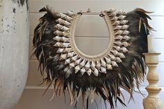 Inspire your space with the Island Child tribal shell necklace. The bohemian Island Child piece is essential for the boho chic home. This gorgeous handmade shell necklace will create an island vibe...