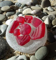 Red sea glass--sea glass is so special to find! But if I found a piece of red, someone would have to call the paramedics..cause I would be so flippin thrilled, I would hyperventilate myself to death.