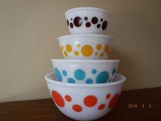 Hazel Atlas Dots Mixing Bowl Set! All 4 pieces Orange, Turquoise, Yellow & Brown, HTF by MadAboutMCModern on Etsy https://www.etsy.com/listing/288386209/hazel-atlas-dots-mixing-bowl-set-all-4