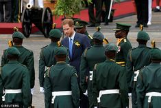 On arrival in Barbados, the prince inspected 108 soldiers in a guard of honour as a 30 str...