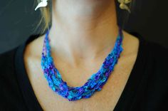 This necklace is made from dazzle ladder yarn imported from Italy. Very light touch, easy to wear, great for travelling! Nylon and Polyester