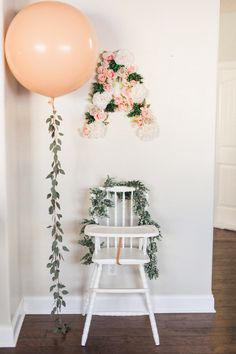 I love the eucalyptus garland idea to hold the balloons. Perfect for the boho baptism.