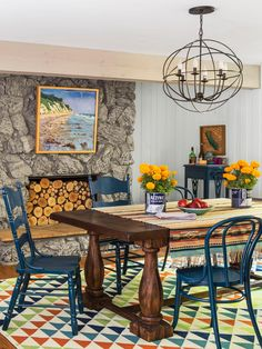 Surrounded by trees and filled with color, HGTV Magazine found a home that's the definition of cozy. // http://www.hgtv.com/design/decorating/design-101/tour-this-warm-woodsy-welcoming-home-pictures?soc=pinterest