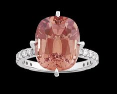 """Malaya Garnet Ring, 8.59 Carats~ A beautiful 8.59-carat Malaya garnet exudes warmth in this stunning ring. Displaying a soft orangy-pink color, this oval-shaped stone is surrounded by 0.77 carat of white diamonds. Hailing from East Africa, its name in Swahili means """"misfit"""" because, at the time of its discovery, it did not fit into any of the standard garnet categories. Known for their durability and radiance, Malaya garnets are becoming increasingly rare. Set in 18K white gold. ~M.S. Rau Gemstones For Sale, Rare Gemstones, Alexandrite, Garnet Rings, East Africa, White Diamonds, Gemstone Colors, Peridot, Pink Color"""
