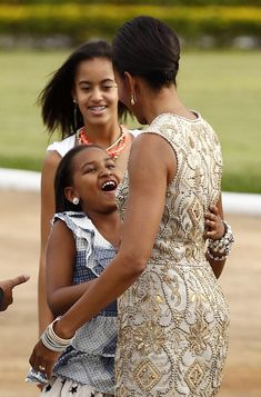 Michelle Obama and daughters. More beading detail! Dress by Naeem Khan