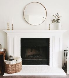 Simple, contemporary and elegant white fireplace & decor
