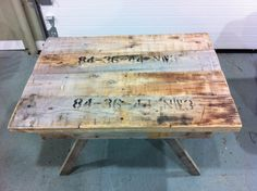 table made out of pieces of wood from old round electrical cable reels..