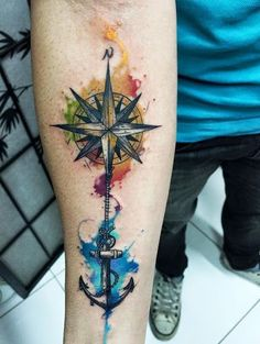 Watercolor anchor and compass tattoos designs on inner arm for men.