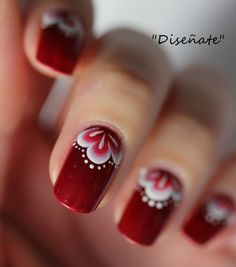 Red nails with fancy design