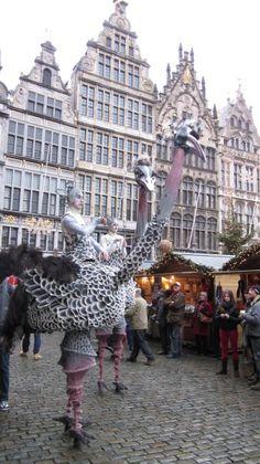Stilt-walkers birds on Antwerp's Christmas market