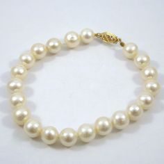 8.5 MM Pearl Bracelet with 14K Yellow Gold Clasp. $225