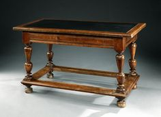 A Second Renaissance /17th century, French, walnut, centre table with a slate inset top
