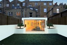 Side Return and Rear Extension with full width sliding doors. The render provides lots of drama against the brick