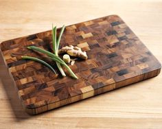 A homemade wood cutting board would make great gifts for all the upcoming weddings. It would be extra special if I could figure out how to monogram it.