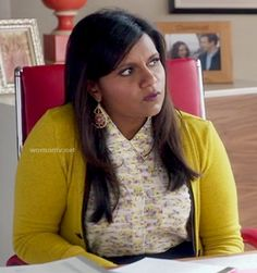 Mindy's yellow cardigan and printed shirt on The Mindy Project.  Outfit details: http://wornontv.net/13974/
