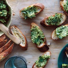 Springtime in Tuscany means eating young green fava beans with salty, nutty crumbles of Pecorino Toscano—a firm sheep's-milk cheese. That favorite snack was a jumping-off point for these savory little toasts. Fresh arugula, both puréed and roughly chopped, punctuates the spread with spice and texture. If you can't get your hands on fresh fava beans, frozen edamame work well, too.