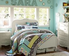 Tween girls love the bright turquoise with black accents.  Love the round mirrors.  These colors pop with white furniture.