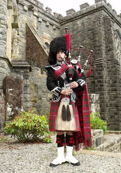 Piper in formal dress at St. Conan's Kirk
