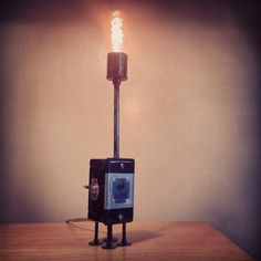 This piece was developed for our new customers who enjoy our creations, but are not quite ready to make a purchase on one of our larger lamps. These great little junction boxes have been transformed into interesting  lamps with a lot of character. These measure approximately 12 inches in size, and each one is handmade by us. Each one differs slightly from the next. This is a great lamp to gift to a friend of family member! $100.00 + shipping