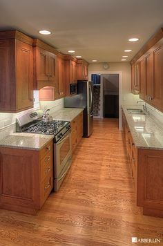Galley kitchen idea; like the cabinets and color. Prefer tile to wood floor.
