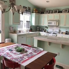 """Lisa Young on Instagram: """"It's been awhile since I posted a picture of my kitchen from this angle.  I'm really loving the new tablecloth. ❤️ #vintagekitchen"""" Lisa Young, Green Kitchen, Vintage Kitchen, Kitchen Cabinets, Instagram, Home Decor, Decoration Home, Room Decor, Cabinets"""