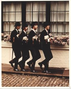 The Beatles looking so very British!