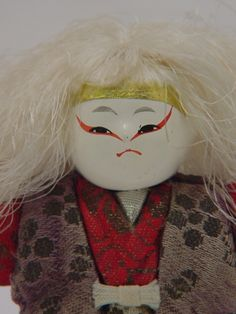 """This Japanese handmade doll is made of wood and has been carefully hand painted to evoke the mesmerizing fierceness of the White Lion character from theNohplay """"Renjishi"""", which means, """"The Lion Dance""""."""