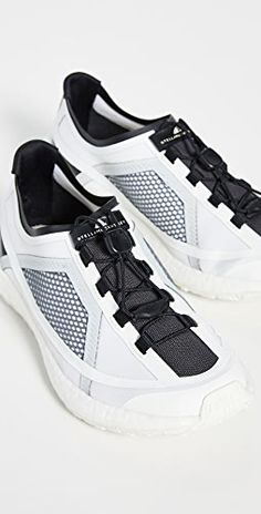 Fabric: Technical knit Mesh overlay Jogger sneakers Lace-up at top Rounded toe Rubber sole Imported, Vietnam This item cannot be gift-boxed Classy Yet Trendy, Sarah Richardson, Fall Capsule Wardrobe, Tennis Dress, Ski Pants, Cream White, White White, Stella Mccartney Adidas, Joggers