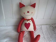 Kočička s červenými puntíky
