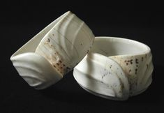 Two sculptural conus shell bracelets are from Sarawak, North Borneo. | The tribal people of the Indonesian Archipelago believed that any closed circle provided a protective barrier against hostile forces, making these bracelets much more than mere adornment. | Early 20th century