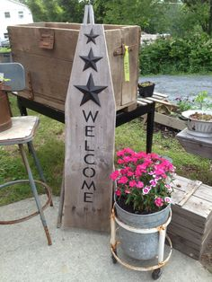This is an old ironing board that I made a welcome stencil for and put the (3) stars on it.  Checkout my facebook page www.facebook.com/countrysidecreationsusa