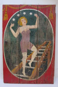 Sideshow painting of a woman juggling 4 balls while standing on a swords ladder.The painting on wood panel was the door on the barkers podium and retains the wood knob on the left side and would have had hinges on the tight edge. This would have been from a traveling carnival that wintered in southern Texas. Each of the paintings on the 4 sides of the podium would have been to entice visitors to pay to enter and see the exotic acts and sights. | 1940s | Attributed to Bill Schuck