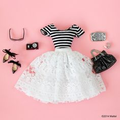 Pairing my favorite striped top with this white lace skirt to give it a new look!  #barbie #barbiestyle