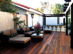 Comfy Seating - Warm, Contemporary Backyard on HGTV.  another view, with seating at high end outdoor kitchen