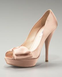 Prada satin platform pumps... $690... that bow and color might be perfect with the champagne satin...