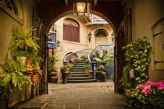 Courtyard Gateway | Flickr - Photo Sharing! The Courtyard of Angels, Disneyland.  Photo by Andy Castro.