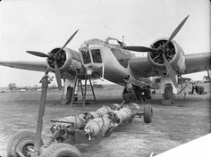 Ordnance is loaded on an RAF Bristol Blenheim Mark IV of No. 40 Squadron at Wyton, Cambridgeshire. Air Force Bomber, Air Force Aircraft, Ww2 Aircraft, Fighter Aircraft, Military Aircraft, Fighter Jets, Bristol Blenheim, Aircraft Photos, Ww2 Planes