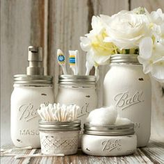 Mason Jar Bathroom Storage & Accessories Painted and distressed mason jars for use to hold bathroom accessories. Great for shabby chic and rustic decor. Pot Mason Diy, Mason Jar Crafts, Uses For Mason Jars, Ball Mason Jars, Bathroom Organisation, Bathroom Storage, Bathroom Hacks, Bathroom Cupboards, Dorm Bathroom Decor