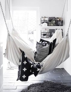 A hammock is the perfect place to recline and relax. Install an indoor hammock for beachy relaxation all year long. For more indoor hammock design ideas, visit domino.