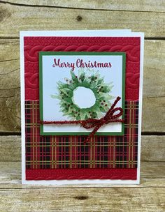 This wreath Christmas card uses Stampin' Up!'s Painted Harvest stamp set, Christmas Around the World designer paper, Tinsel Trim Combo Pack, and the Cable Knit Dymamic Embossing Folder. #stamptherapist #stampinup www.stamptherapist.com