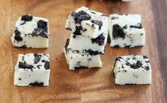 """This 5 Minute Cookies and Cream Fudge says it all in the title. This fudge recipe is an easy dessert recipe and will actually take you under 5 minutes to make! It does not get easier than that. This 5 minute recipe is better than any fudge shops. The homemade fudge recipe is packed with bits of crunchy cookie and rich chocolaty flavor. This is the perfect winter dessert recipe. With a simple fudge recipe like this in your recipe book, you can whip up a """"fancy"""" looking dessert in no time."""
