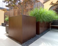 steel planters surrounded by slate chips